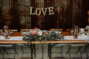 Rustic Native faux flower table arbour arrangement