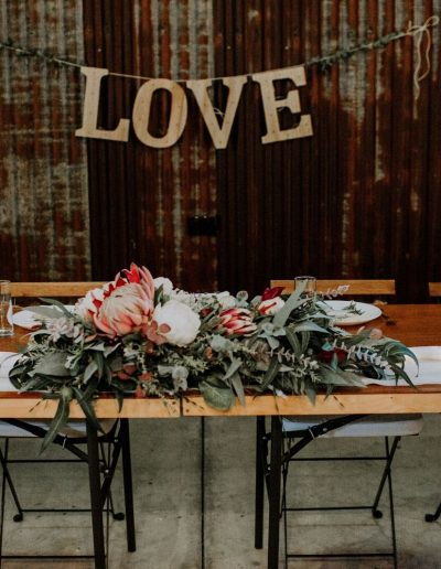 Rustic Native faux flower table arbour arrangement image by Down the rabbithole productions #bloominglovelybouquets