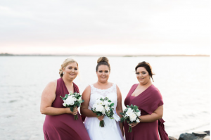 Beach wedding, burgundy maids
