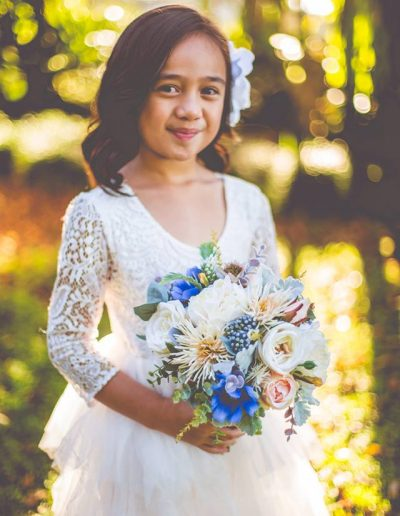 Flower girl - faux flower blue bouquet - rustic wedding - image by Graeme Passmore Photography #bloominglovelybouquets