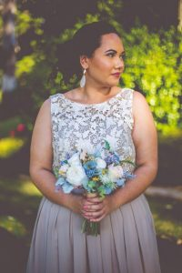 Bridesmaid with faux flowers rustic wedding
