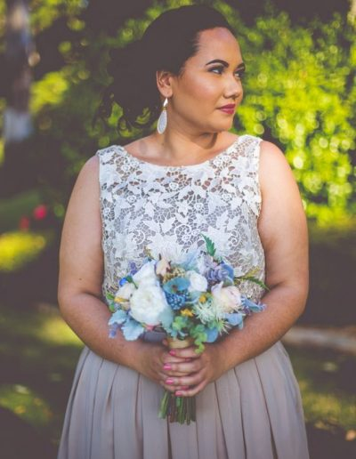 Bridesmaid with faux flowers rustic wedding image by Graeme Passmore Photography #bloominglovelybouquets