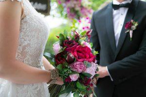 berry toned cascading faux flower bouquet