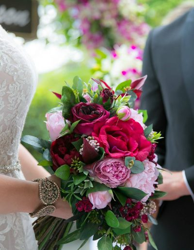 Lush berry toned faux flower bouquet – image by Loui Hart photography