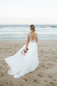 Pink and white bouquet bride on beach