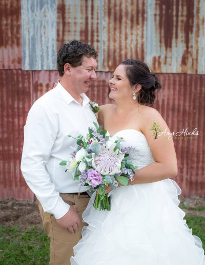 Country rustic wedding flowers – Lilac Bridesmaids – Faux Flower bouquets – image by Amy Hinks Photography