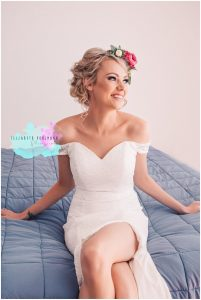 Bride sitting with pink Bridal Flower Crown