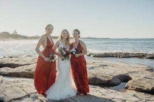 bbeach wedding bride and red maids