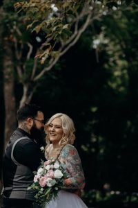 tattooed bride and groom, pink bouquet