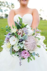 Bride holding Native silk wedding bouquet