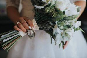 bride holding bouquet stems