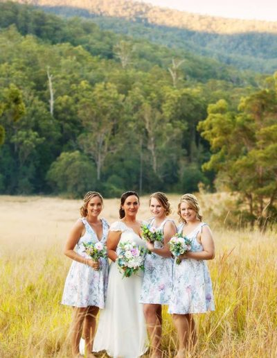 Floral Bridesmaid dresses, pink and blue bouquets, image by Wet Paint Photography
