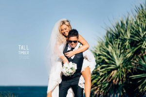 Bride and groom on beach with Succulent bouquet