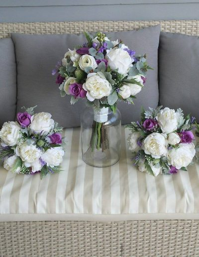Purple and white bouquets faux flowers