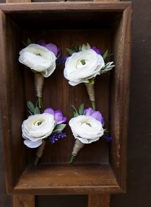 white and purple buttonholes
