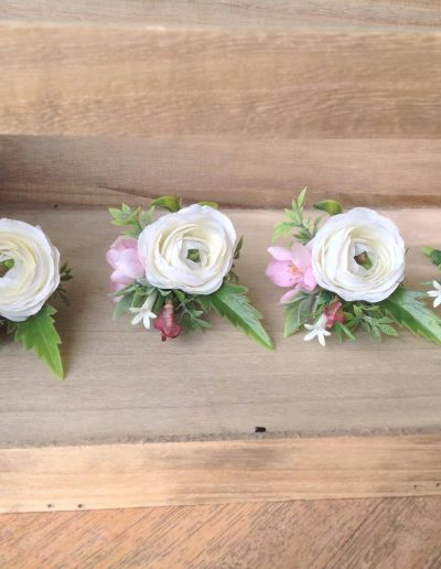 white and pink buttonholes