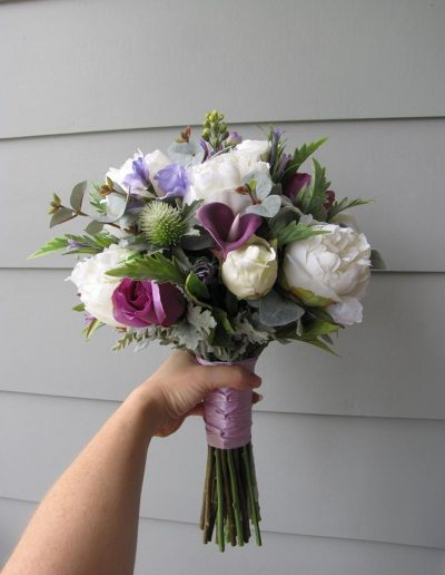 purple and white bouquet faux flowers