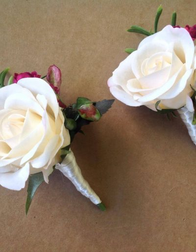 Peach and Burgundy buttonholes