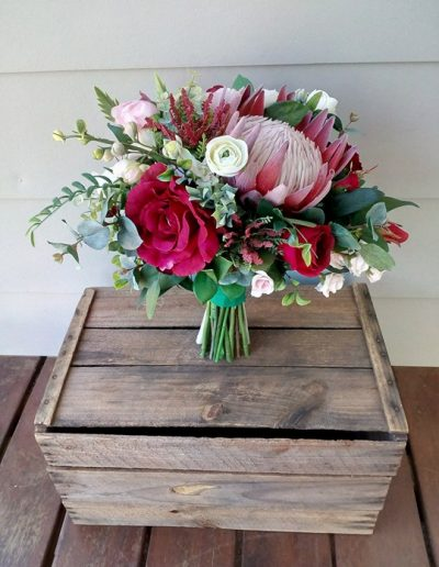 red and pink lush wedding bouquet - faux flowers
