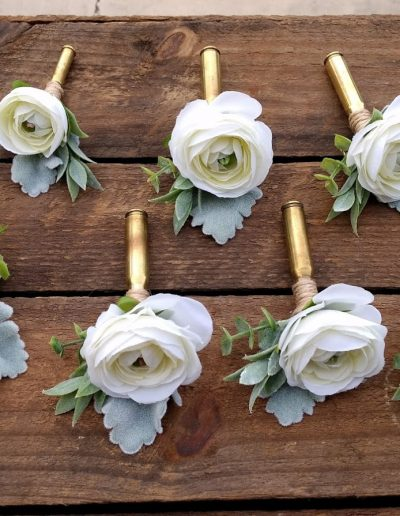 Bullet shell and twine buttonholes faux flowers