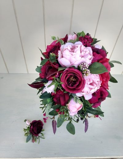 Lush berry toned faux flower bouquet