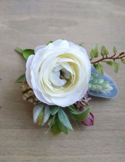 white and pink buttonhole