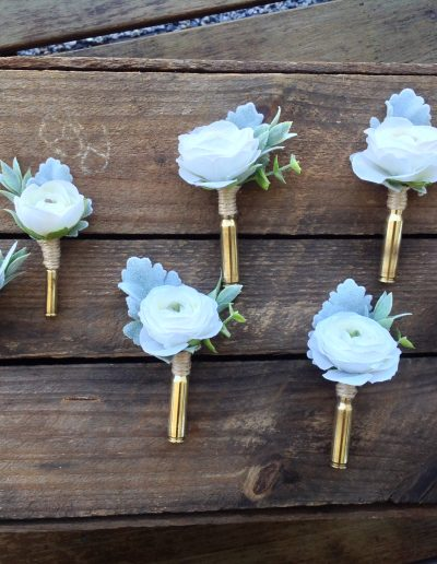 Bullet shell buttonholes - faux flowers country wedding