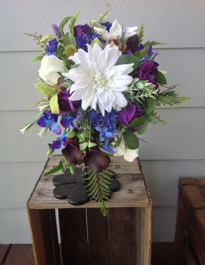 Purple white and blue cascading bouquet faux flowers