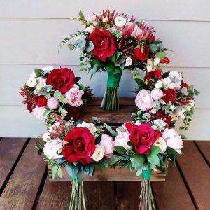 red and pink lush wedding bouquets - faux flowers