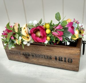 Bright pink and yellow flower crown